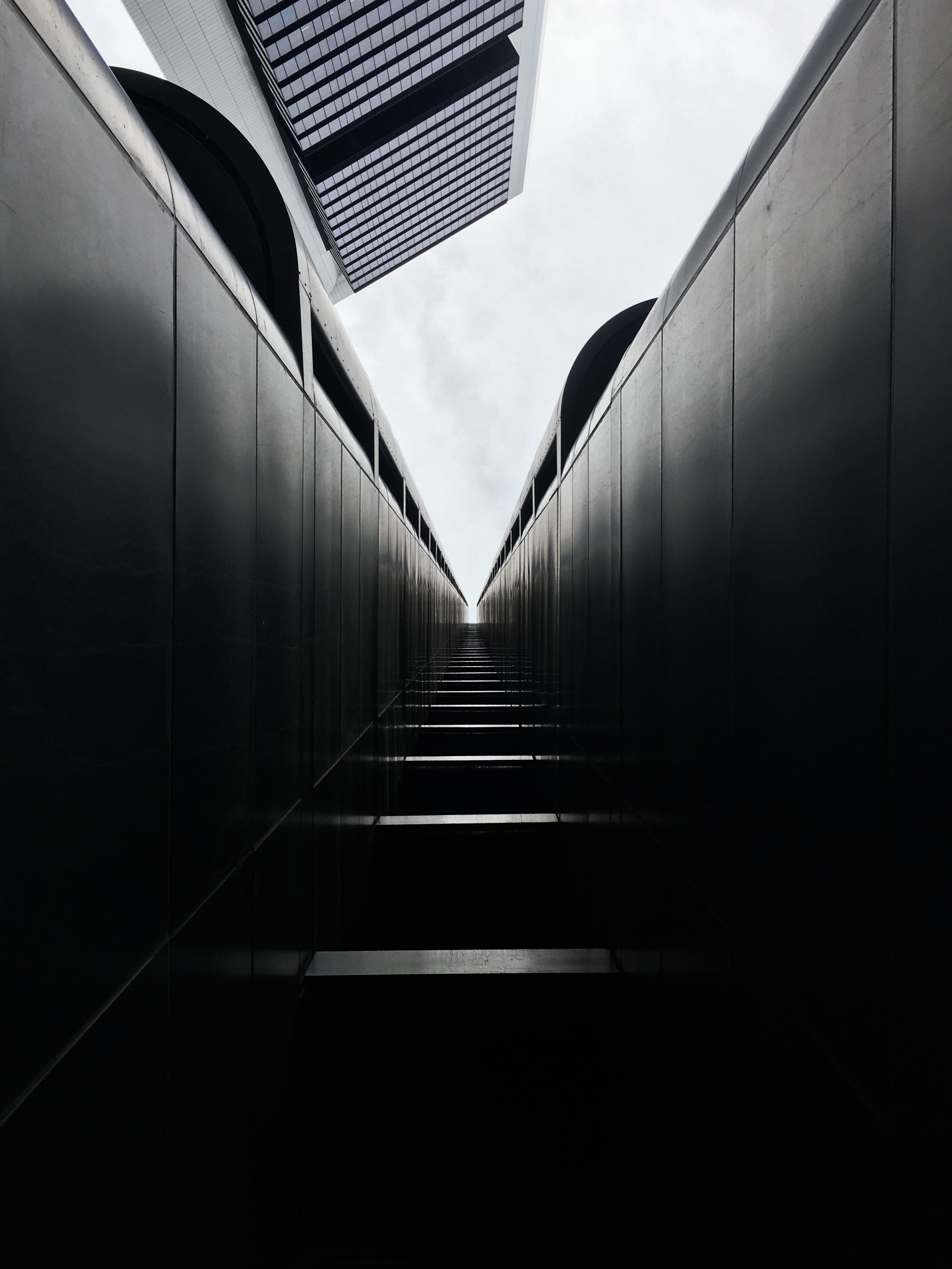 In Madrid, there's a building that has an entrance that sort of looks like a tunnel to the sky. It also looks like stairs but in reality, all I had to do was put my camera flat on the floor, set a timer for the picture and let my phone do all the work.