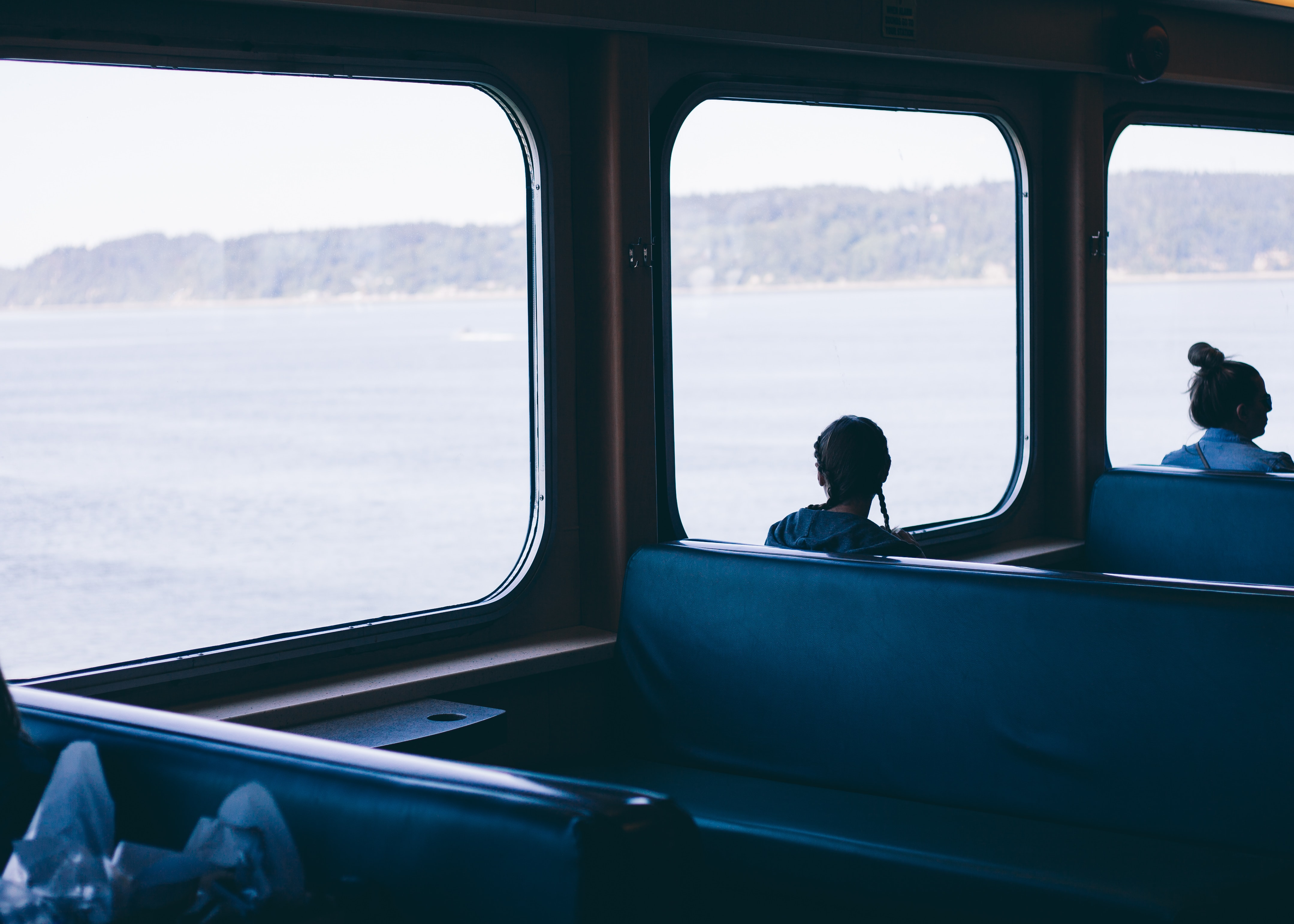 person inside boat overlooking window view