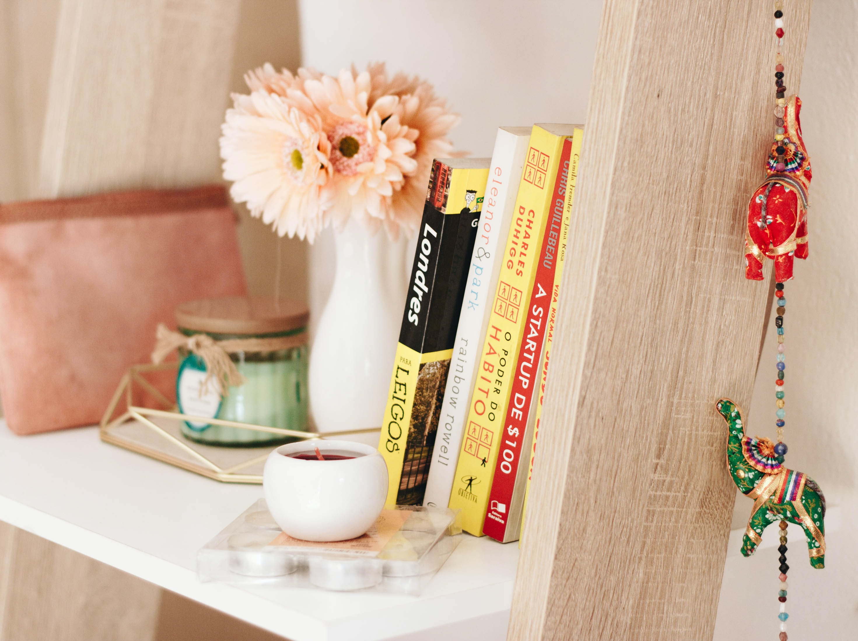 photo of book and candle on shelf
