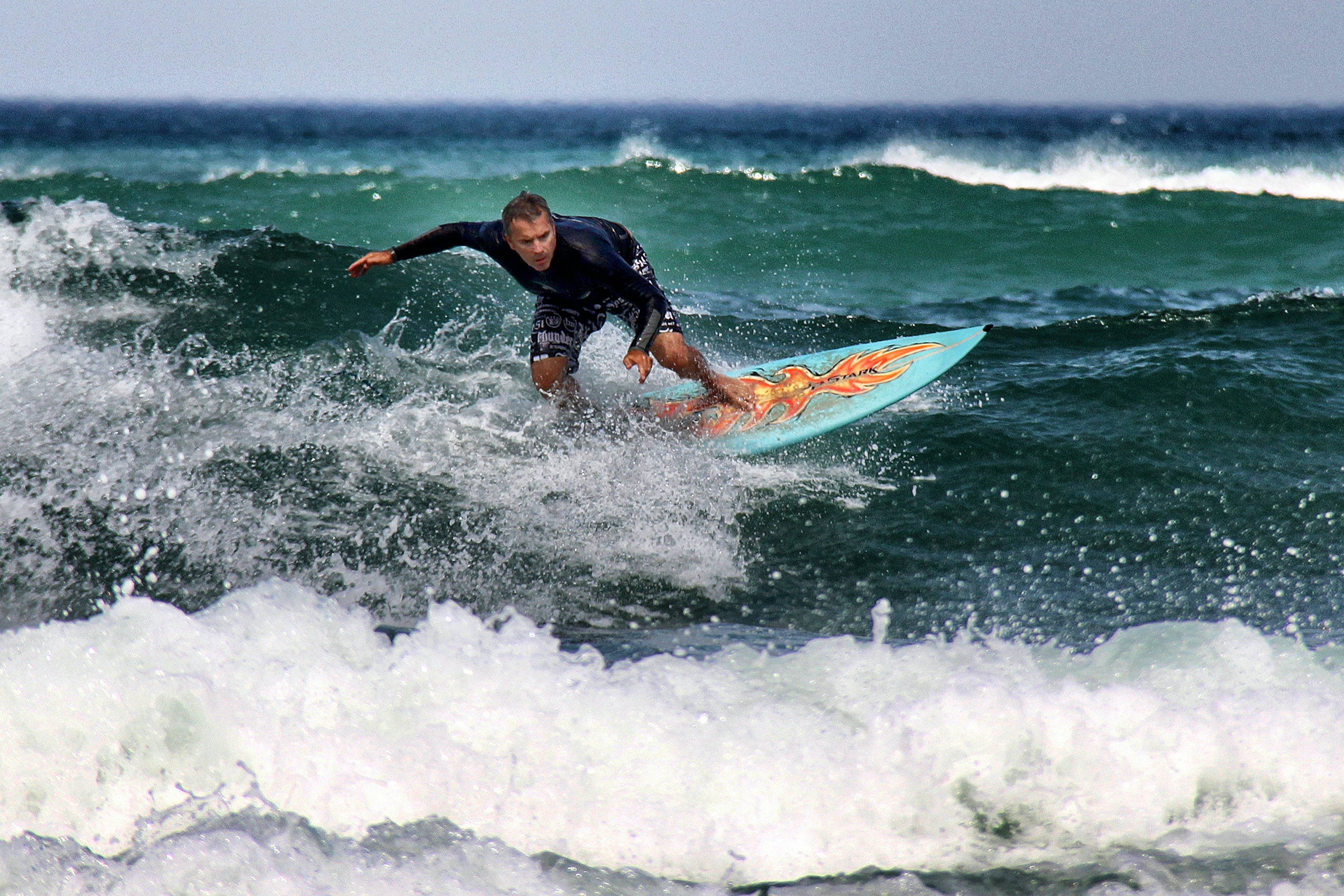 man riding a surfboard during daytime