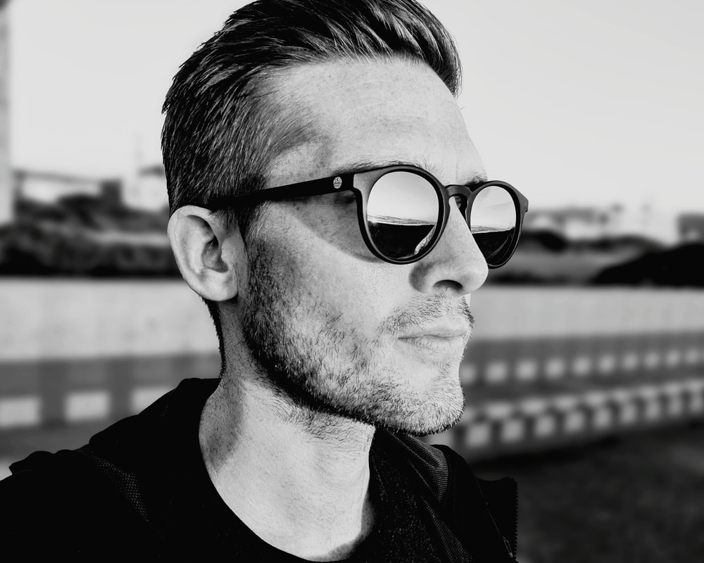 grayscale photography of man wearing sunglasses