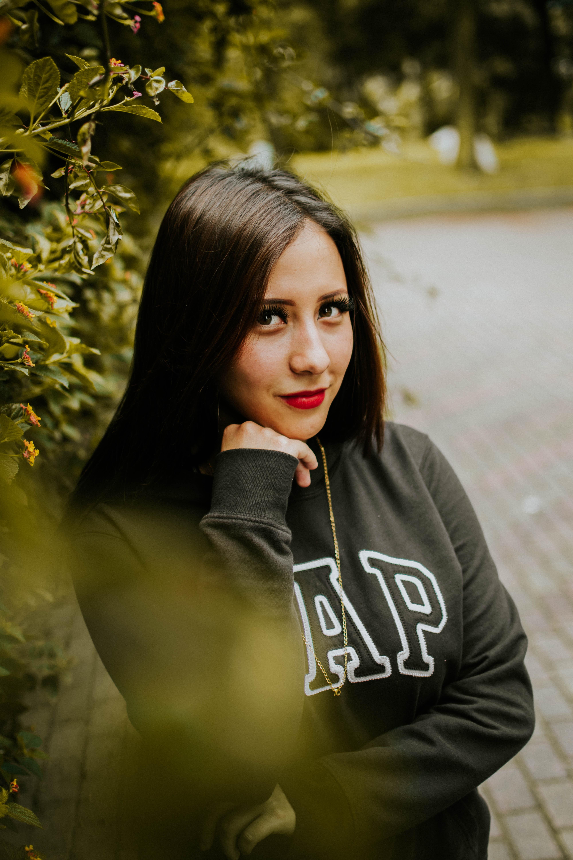 woman wearing black Gap sweatshirt