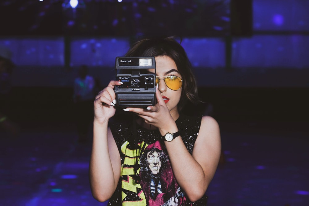 woman taking photo using camera