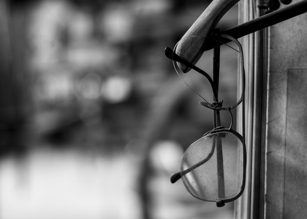 grayscale photo of eyeglasses