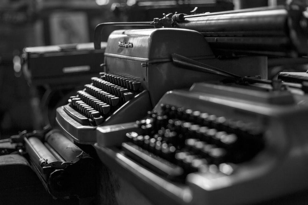 greyscale photo of typewriter