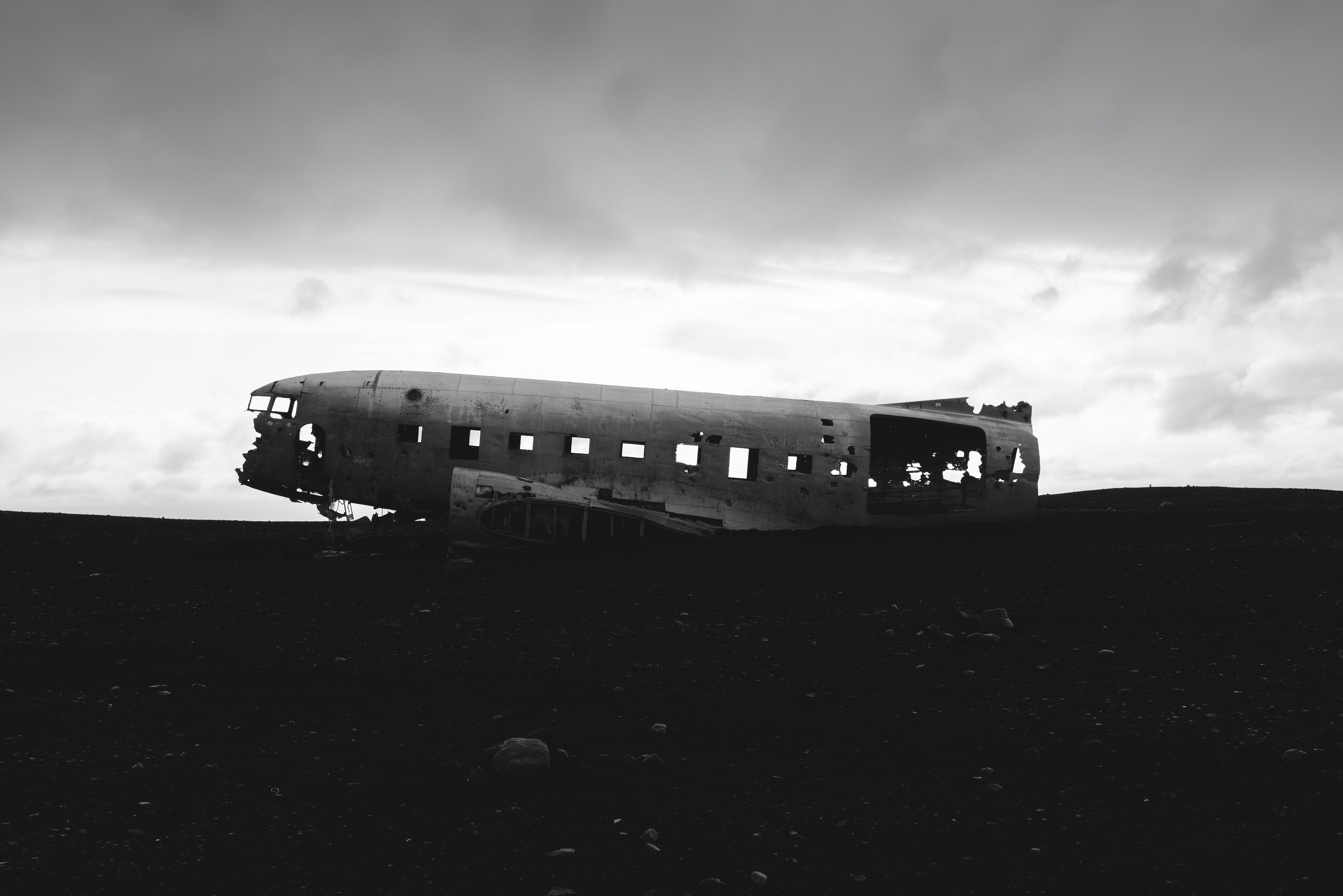 grayscale photography of wrecked plane