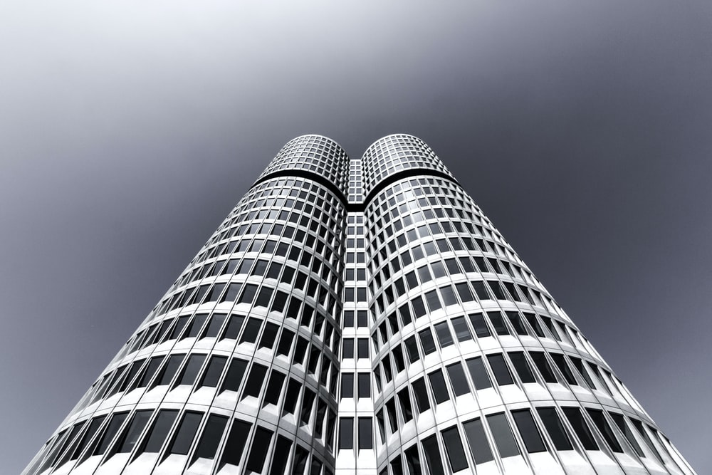 low-angle photography of curtain wall tower building