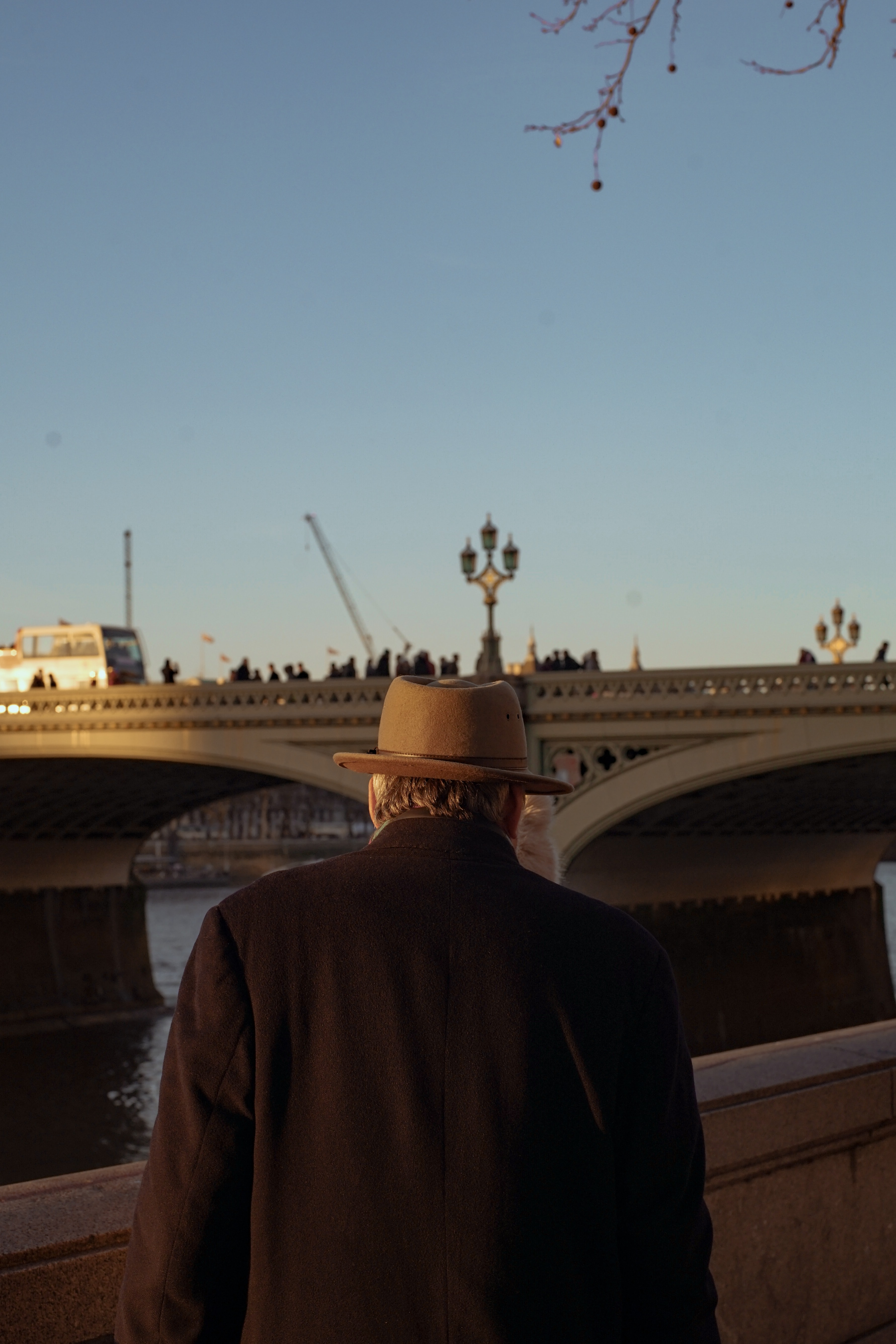 man standing in front of white bridge