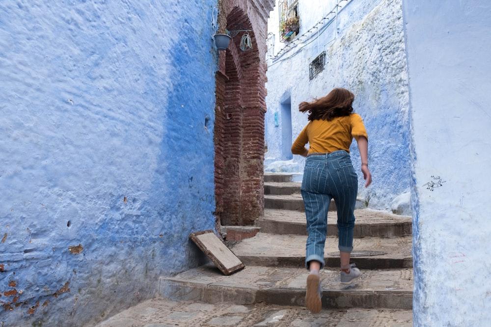 woman walking on concrete steps