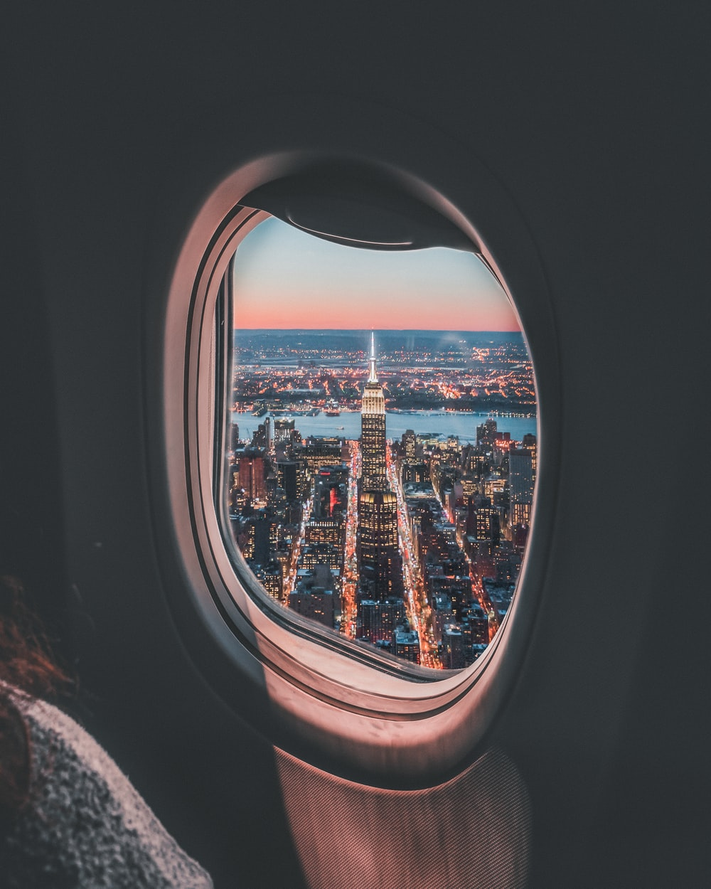plane window photo of Empire State Building