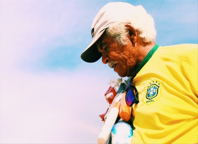 man wearing cap and jersey brazil teams background
