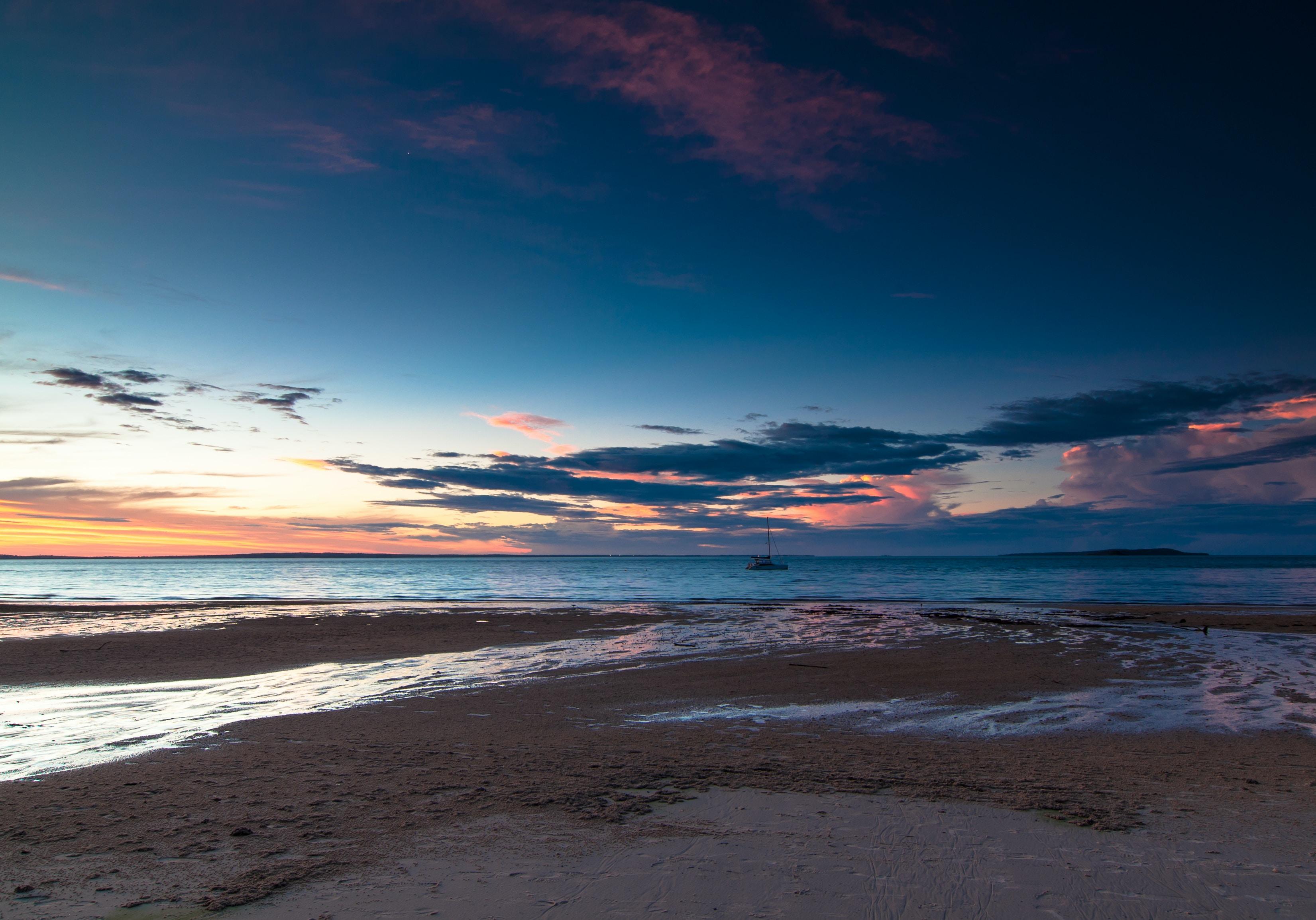 landscape of seashore during dusk