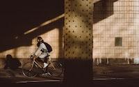 person biking under highway