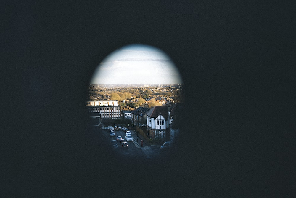 hole photography of village during blue sky
