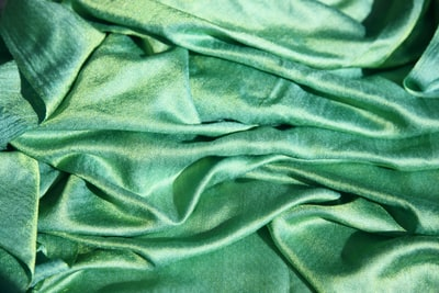 A lovely shade of green in 100% silk makes a soothing background. This is a large scarf that I bought at a local thrift shop for only a few dollars. The silk has a magical shimmery quality to it.