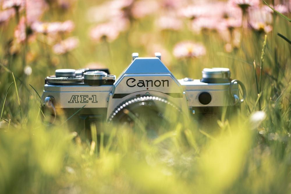 silver Canon AE-1 SLR camera