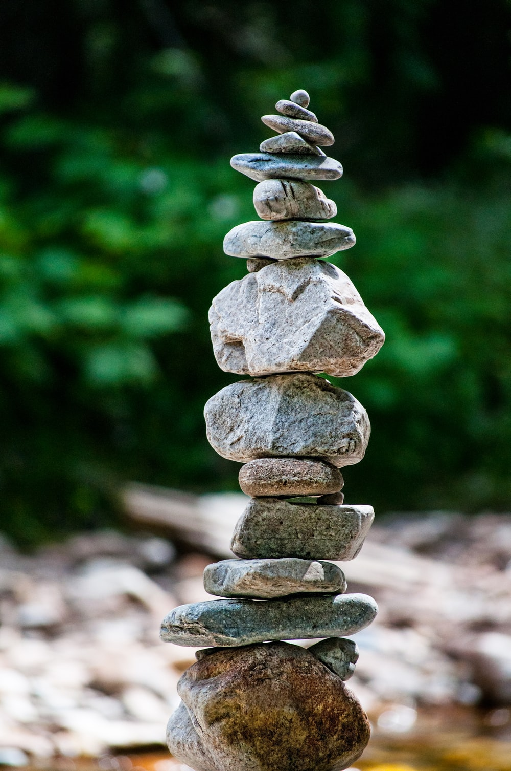 stone balancing in river