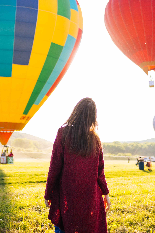 woman standing near hot air balloon
