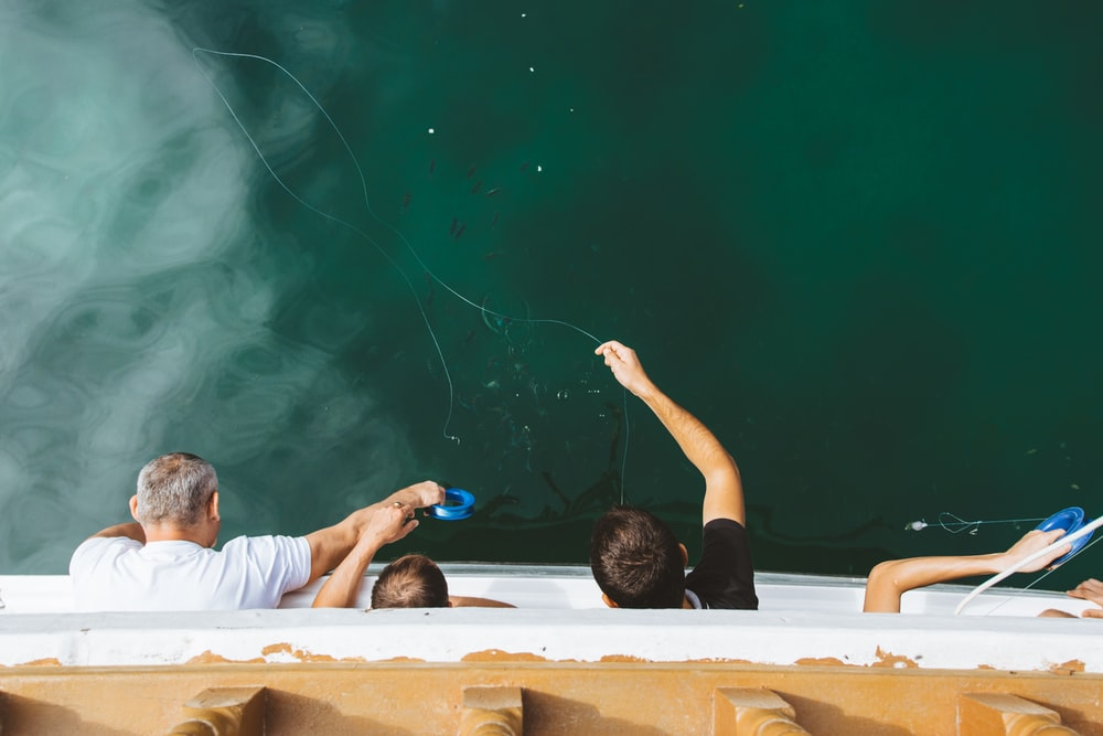 four men on hot tub