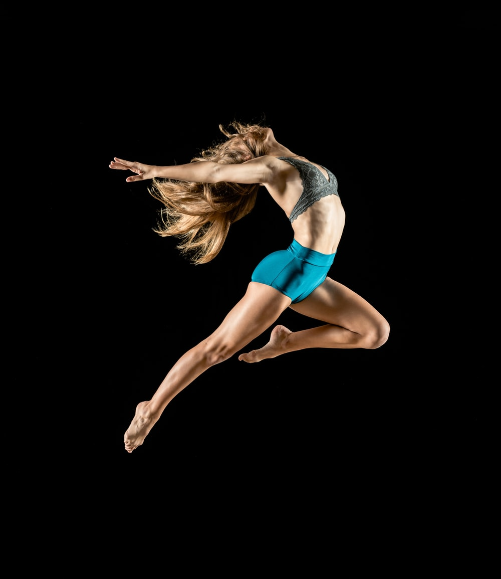 woman jumping and reflex her body