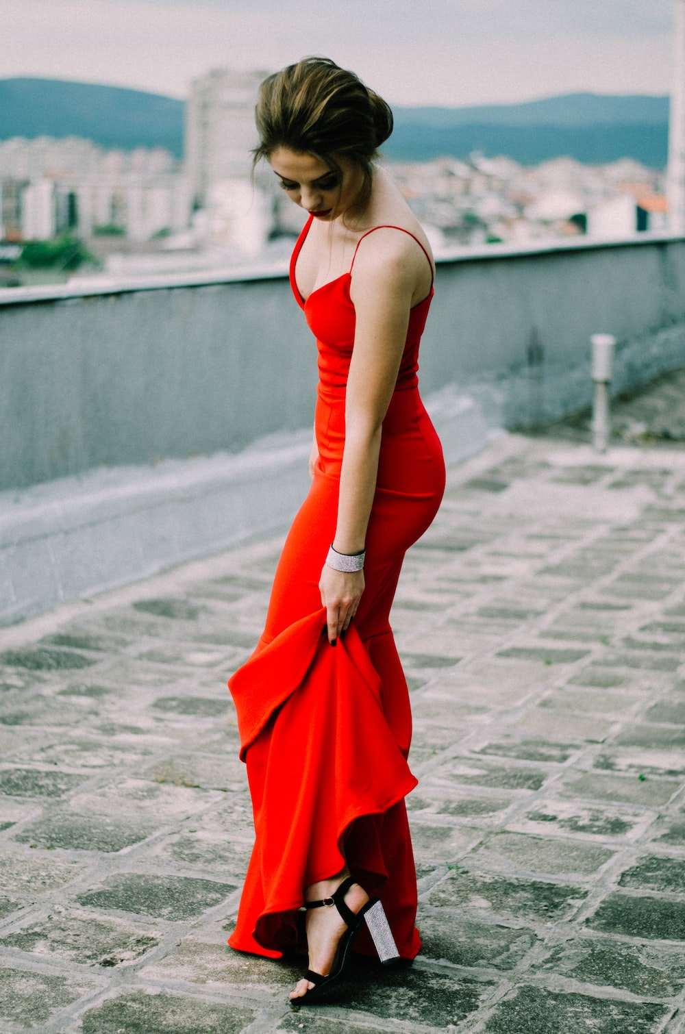 woman wearing red spaghetti strap dress