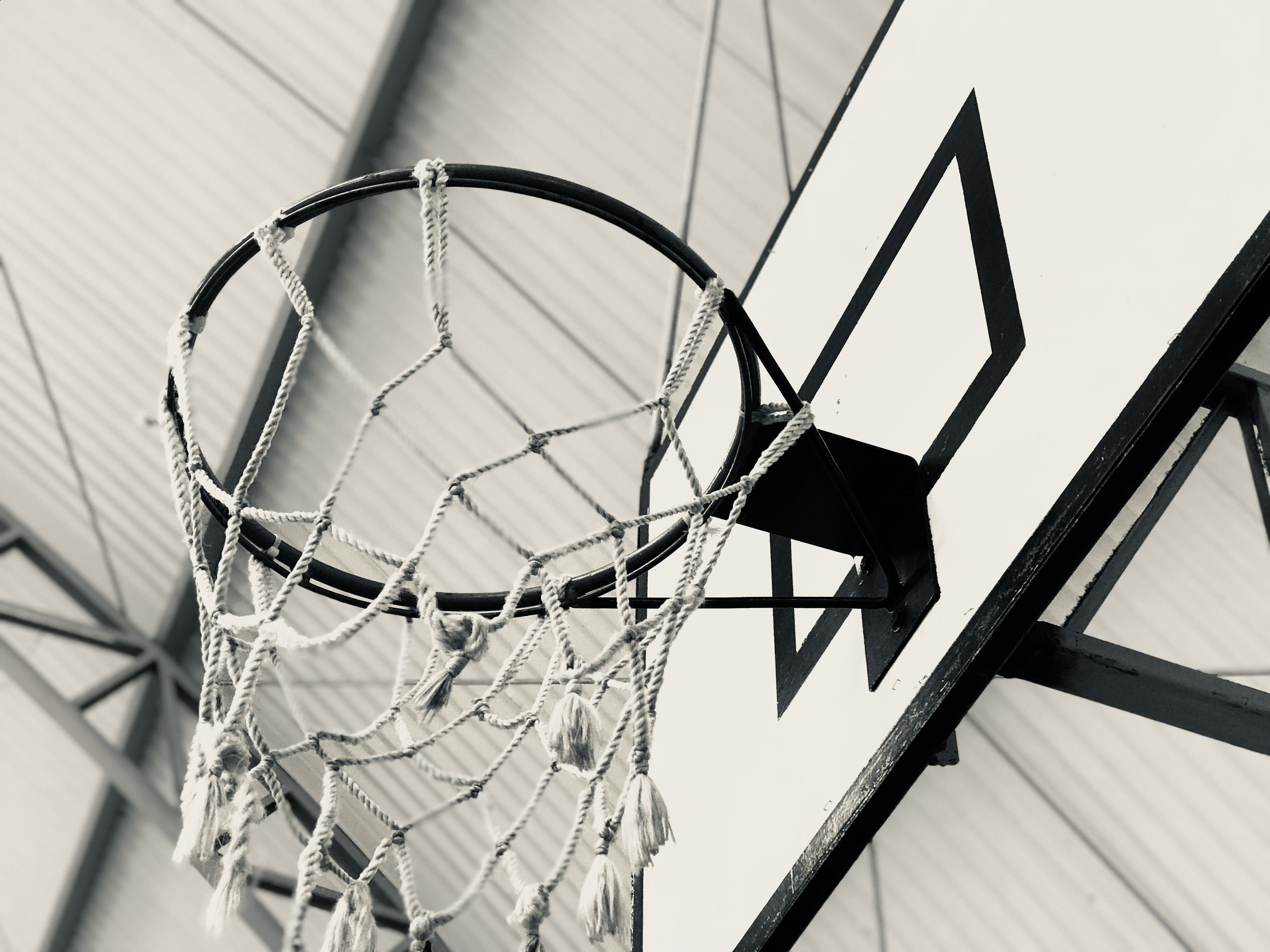 grayscale photography of basketball hoop