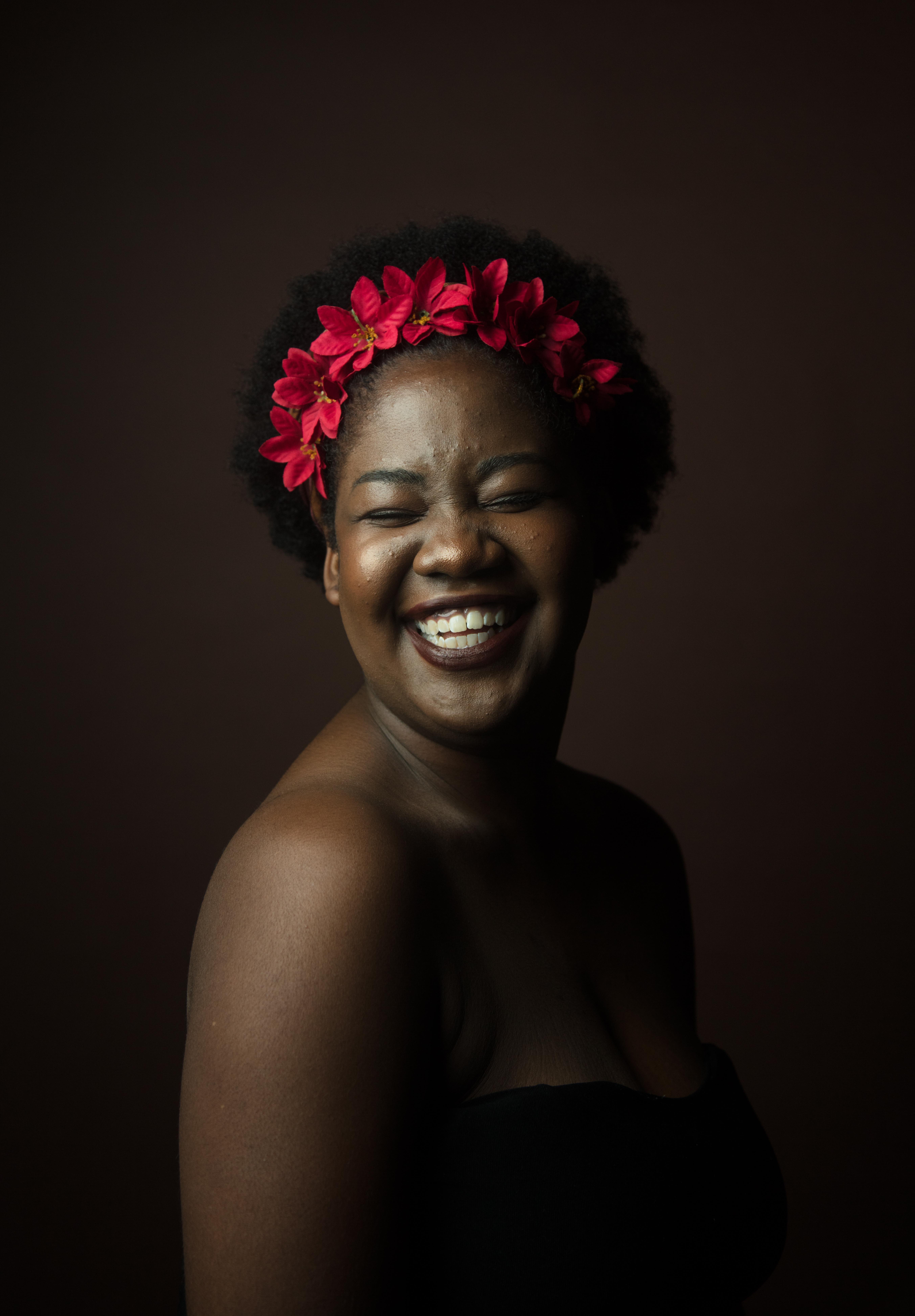 smiling woman wearing black top