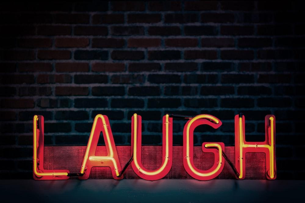 Laugh neon signage