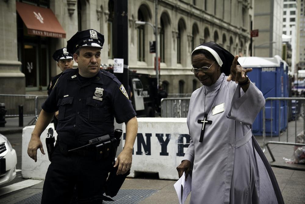 policeman assist a nun