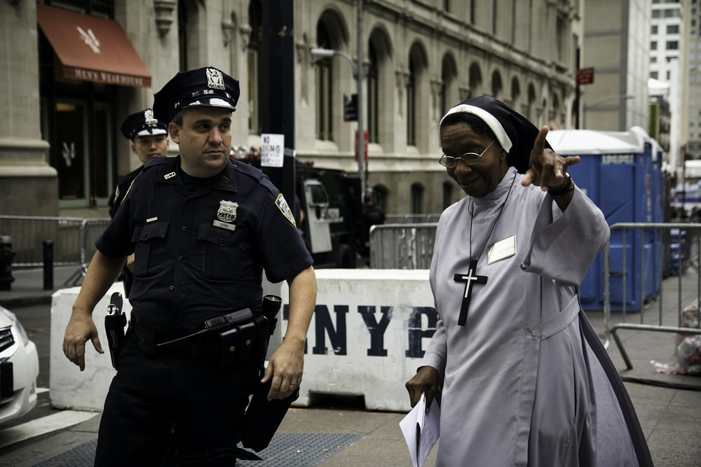 policeman assist a nun