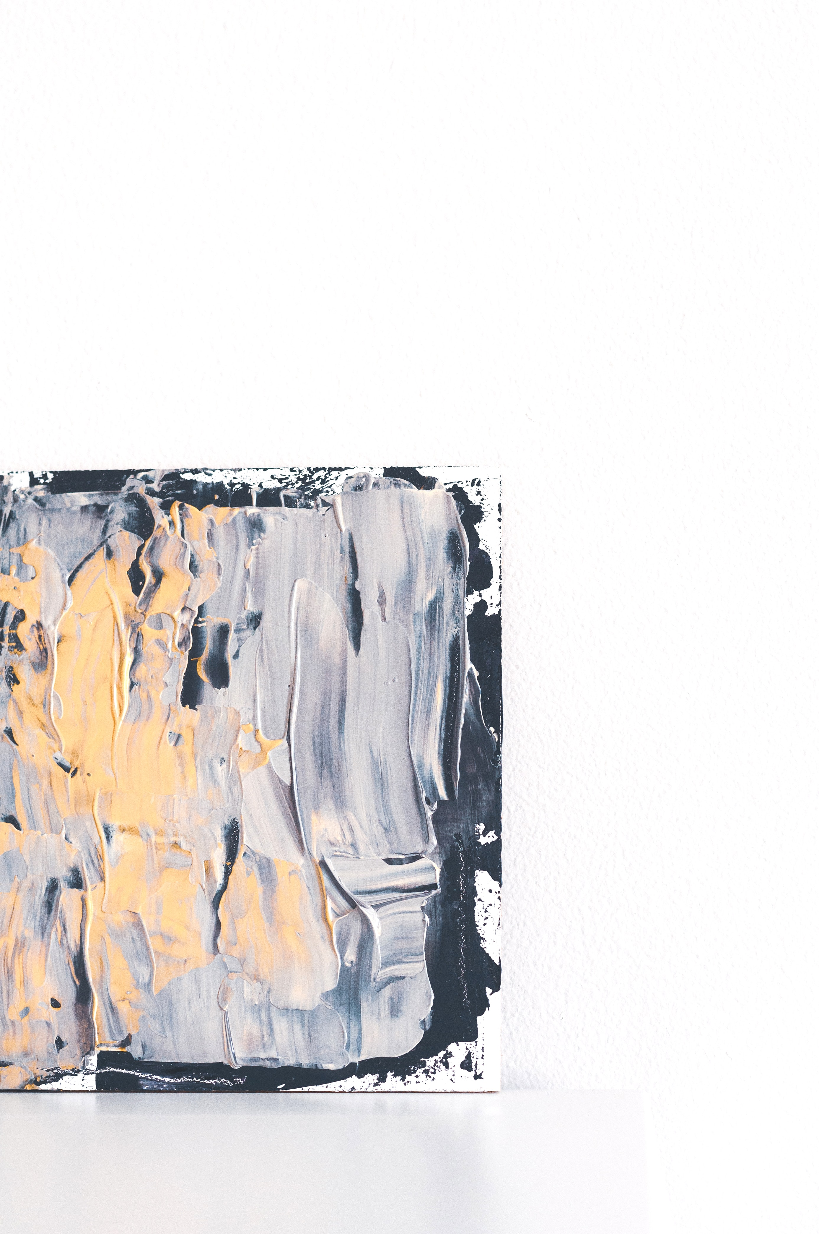 gray and yellow abstract painting