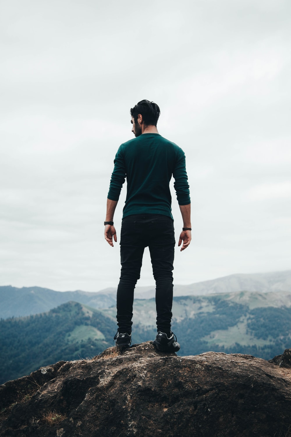 man standing on rock formation