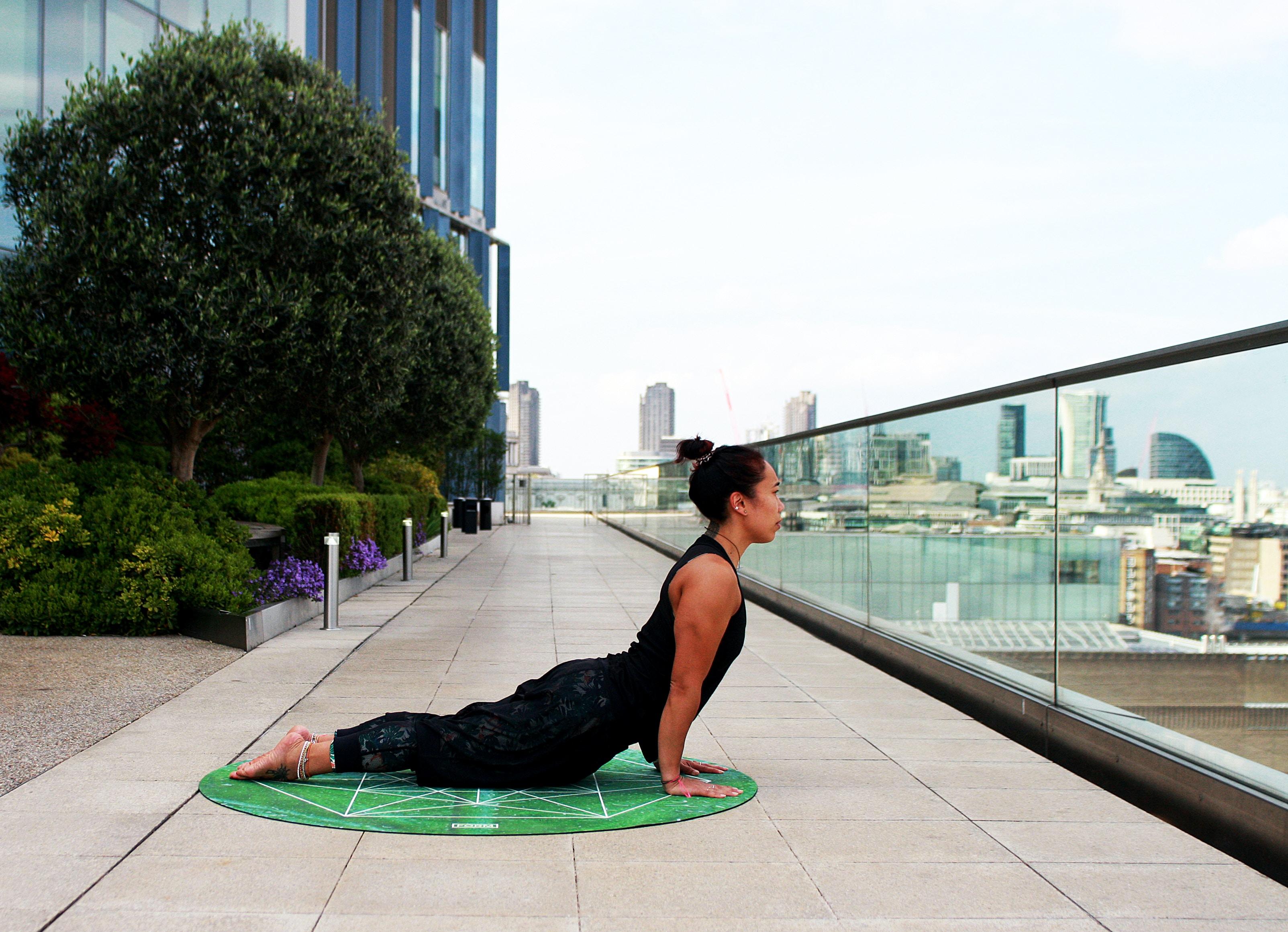 woman lying on mat