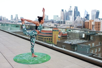 woman exercising on terrace