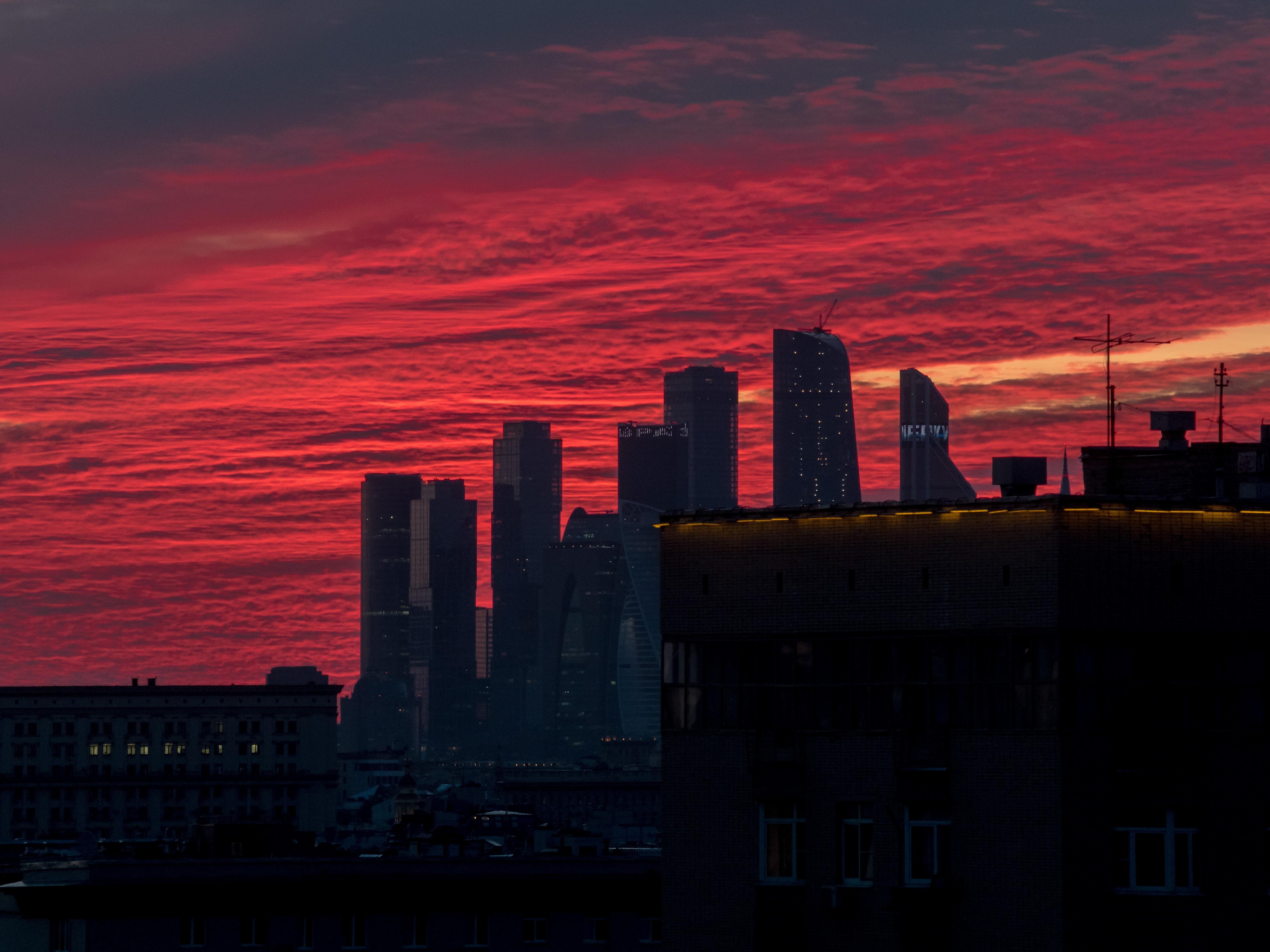 city buildings under sunset