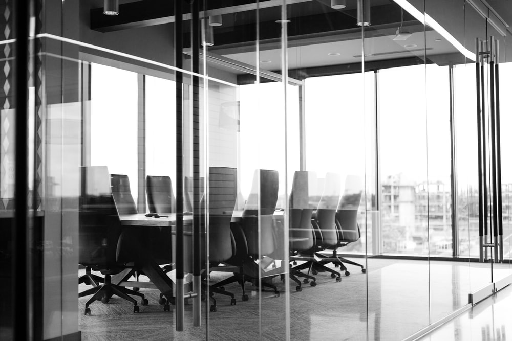 grayscale photography of corporate room