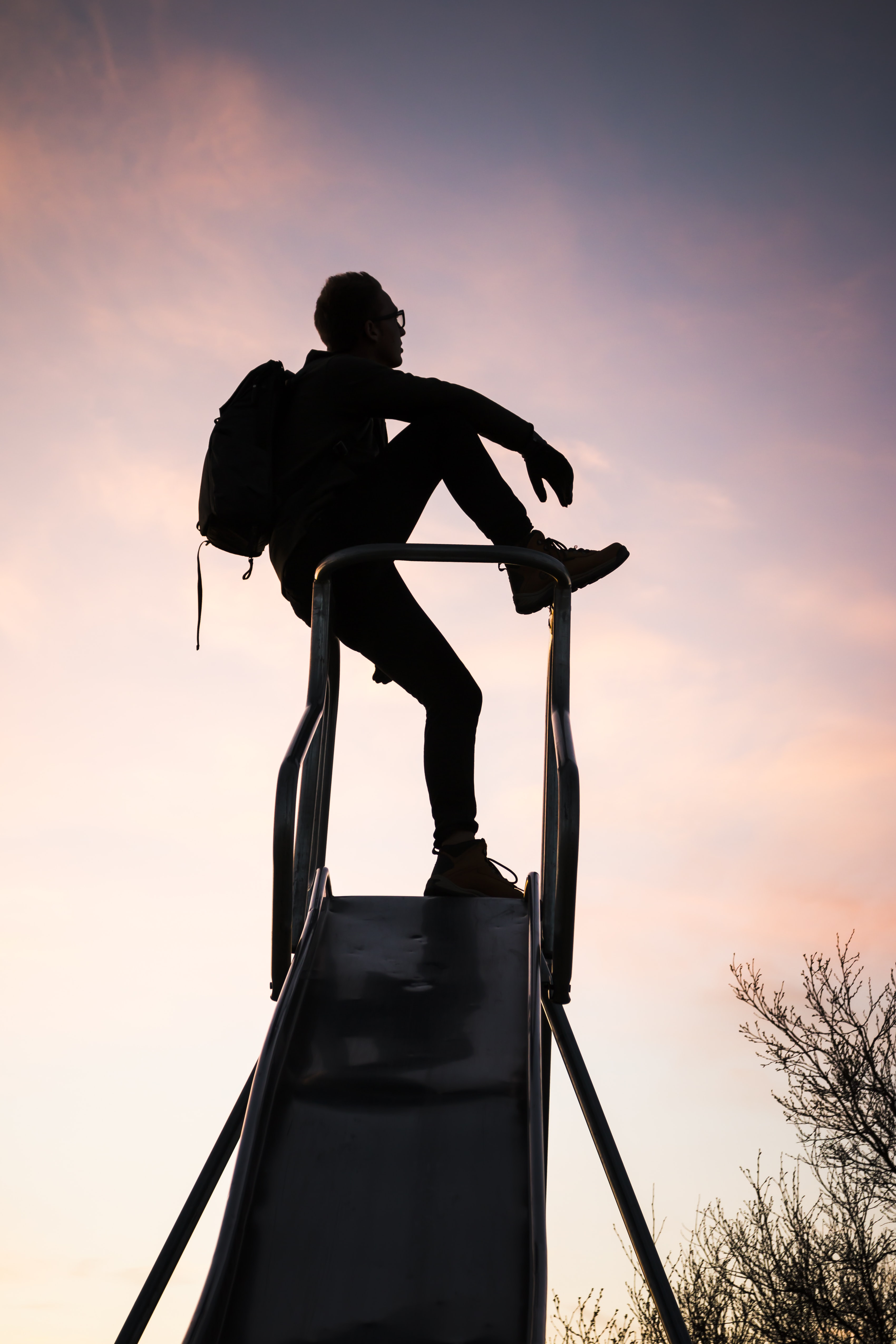 silhouette photography of man with backpack