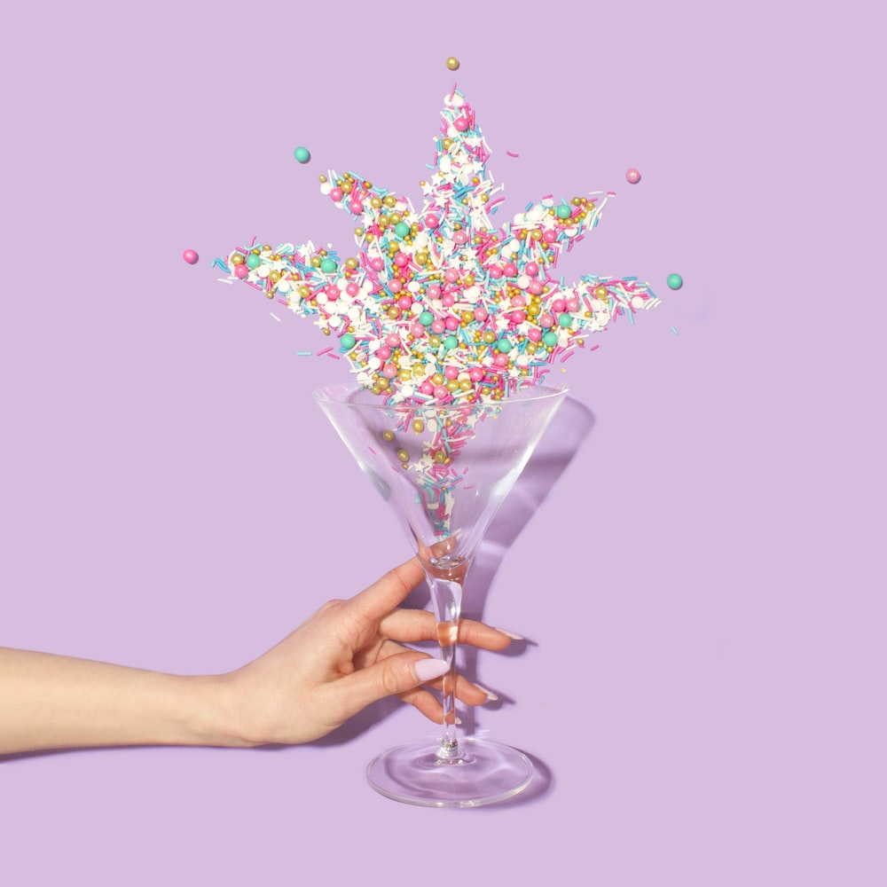 person holding clear martini glass
