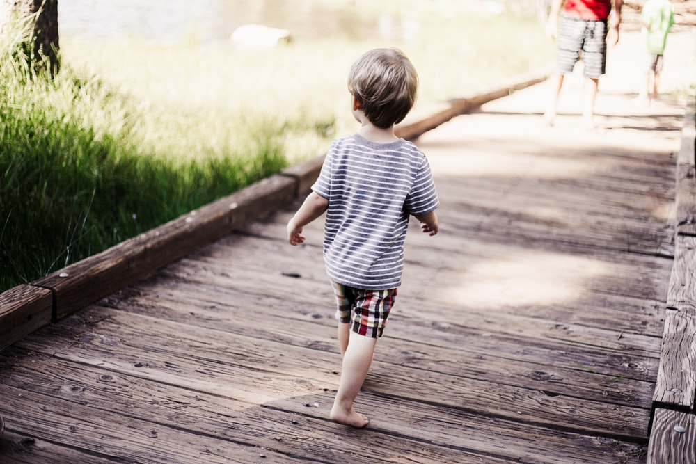 child walking on bridge
