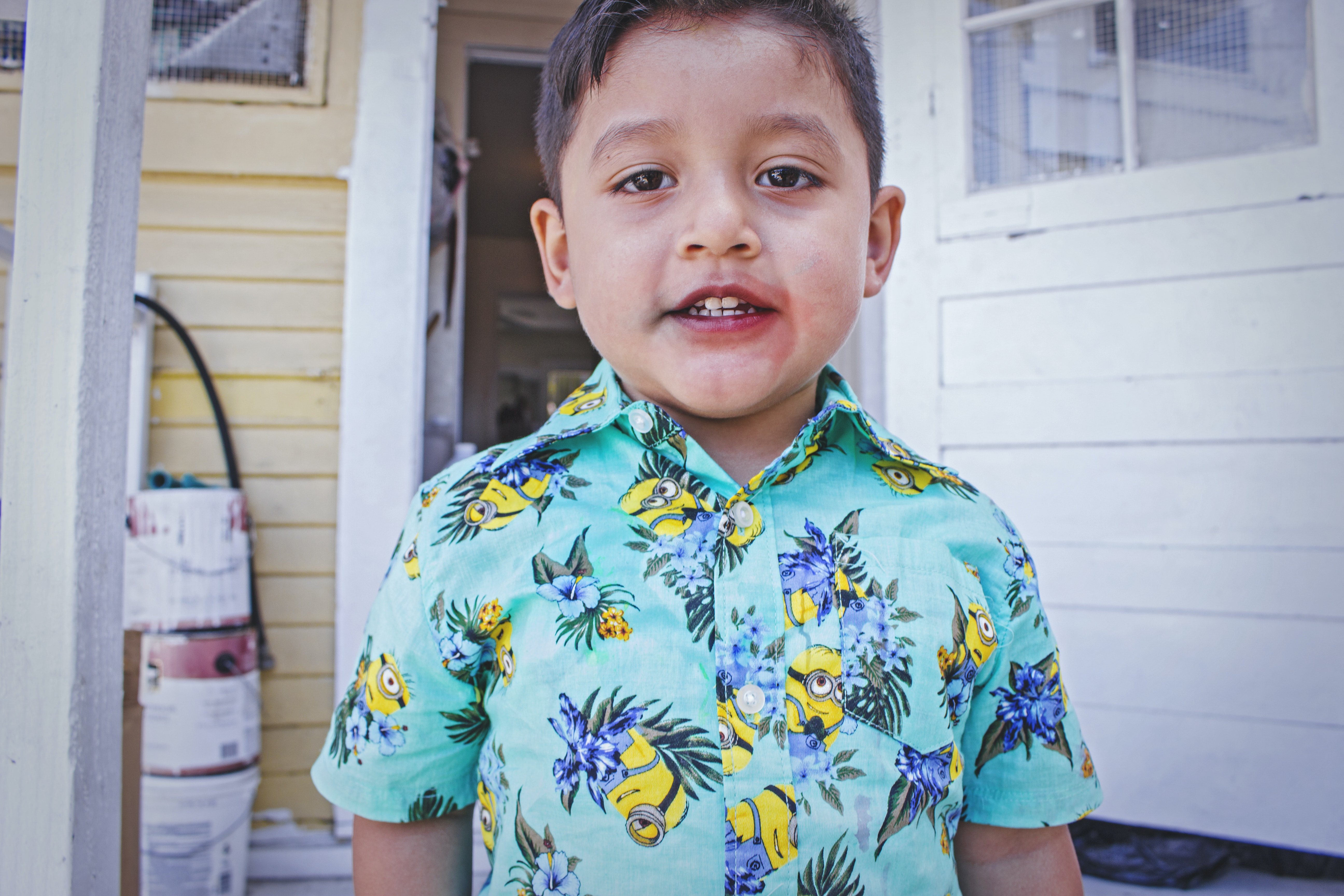boy wearing multicolored floral button-up shirt