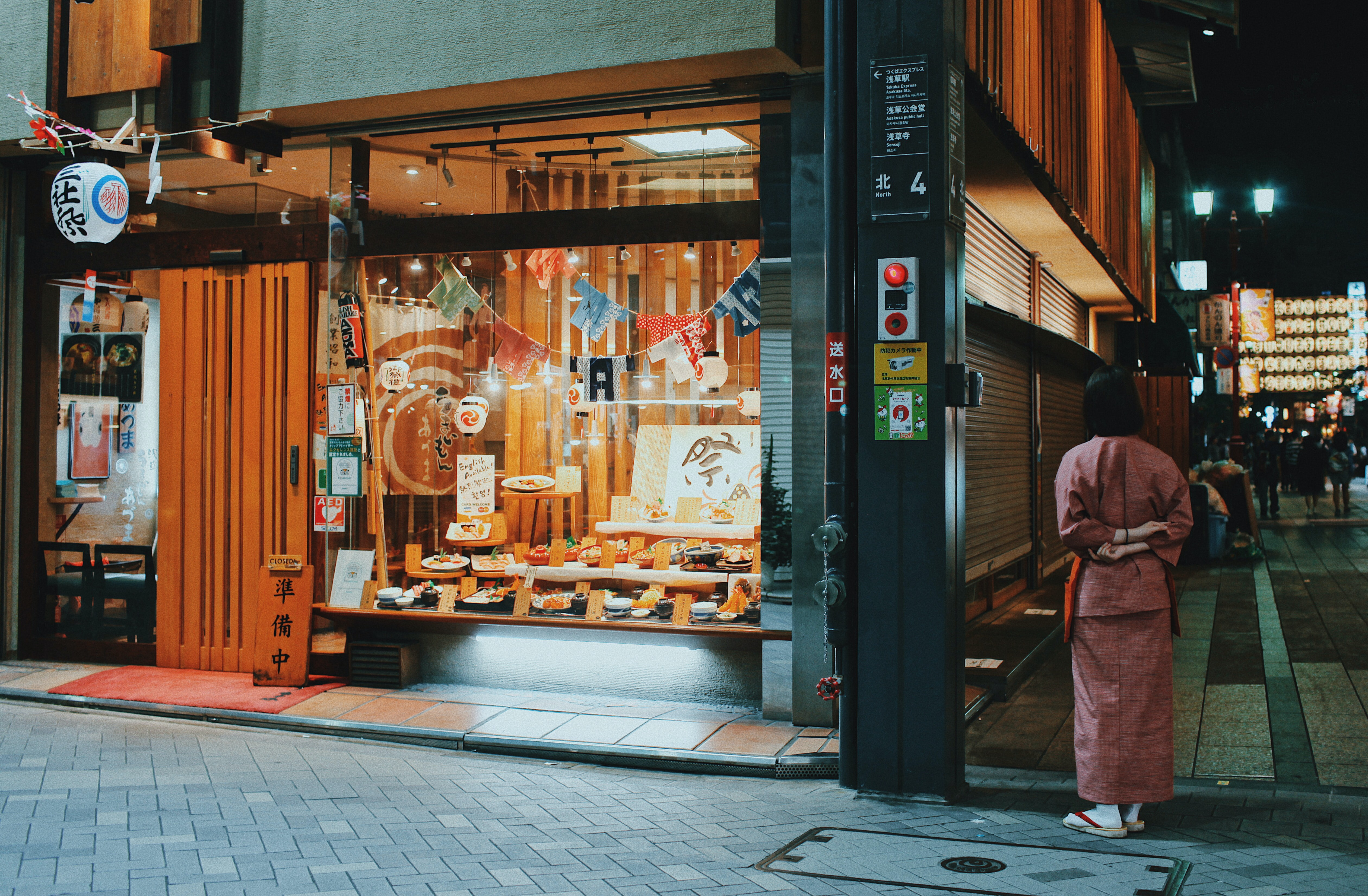 woman standing near cafe