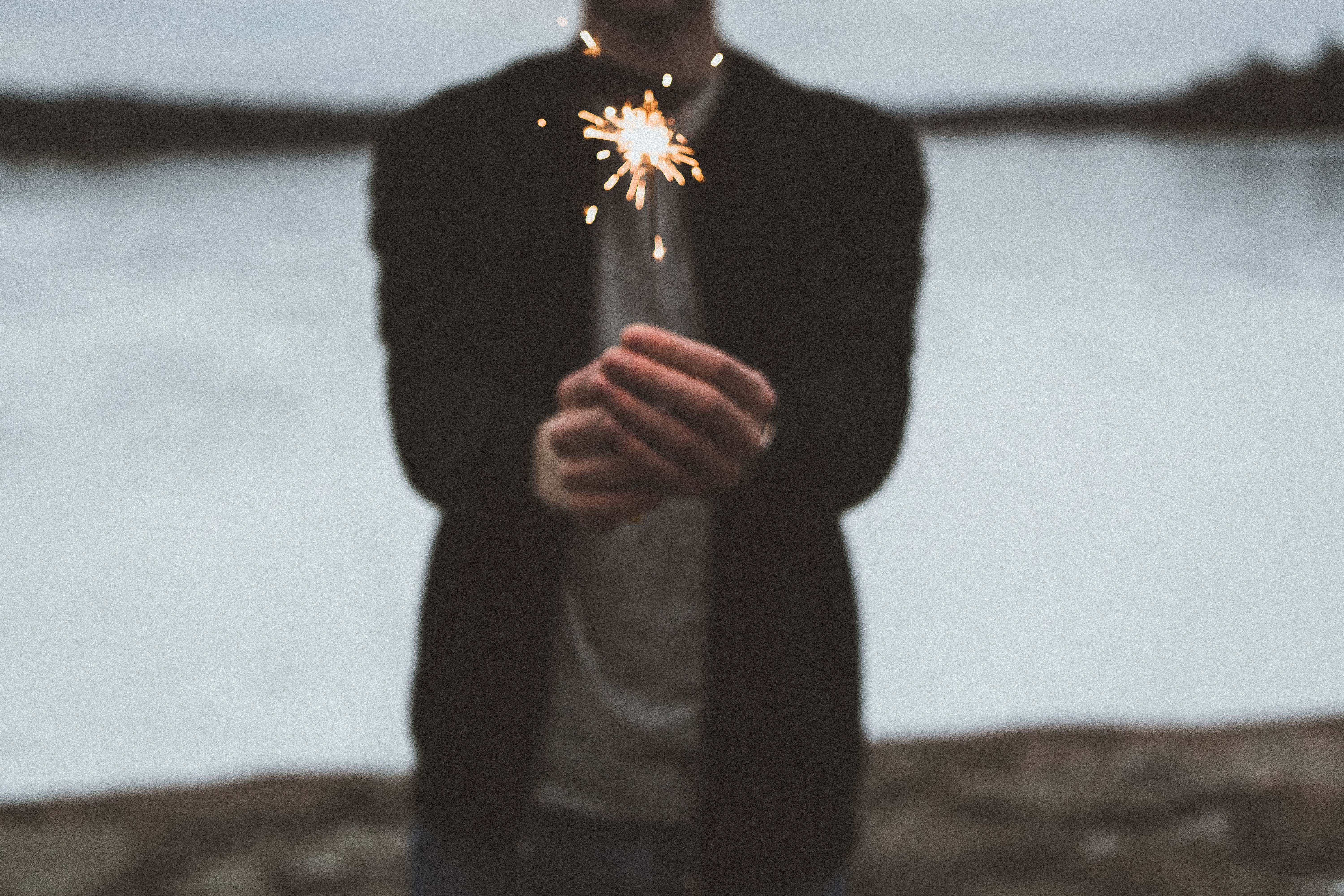person playing with handheld fireworks