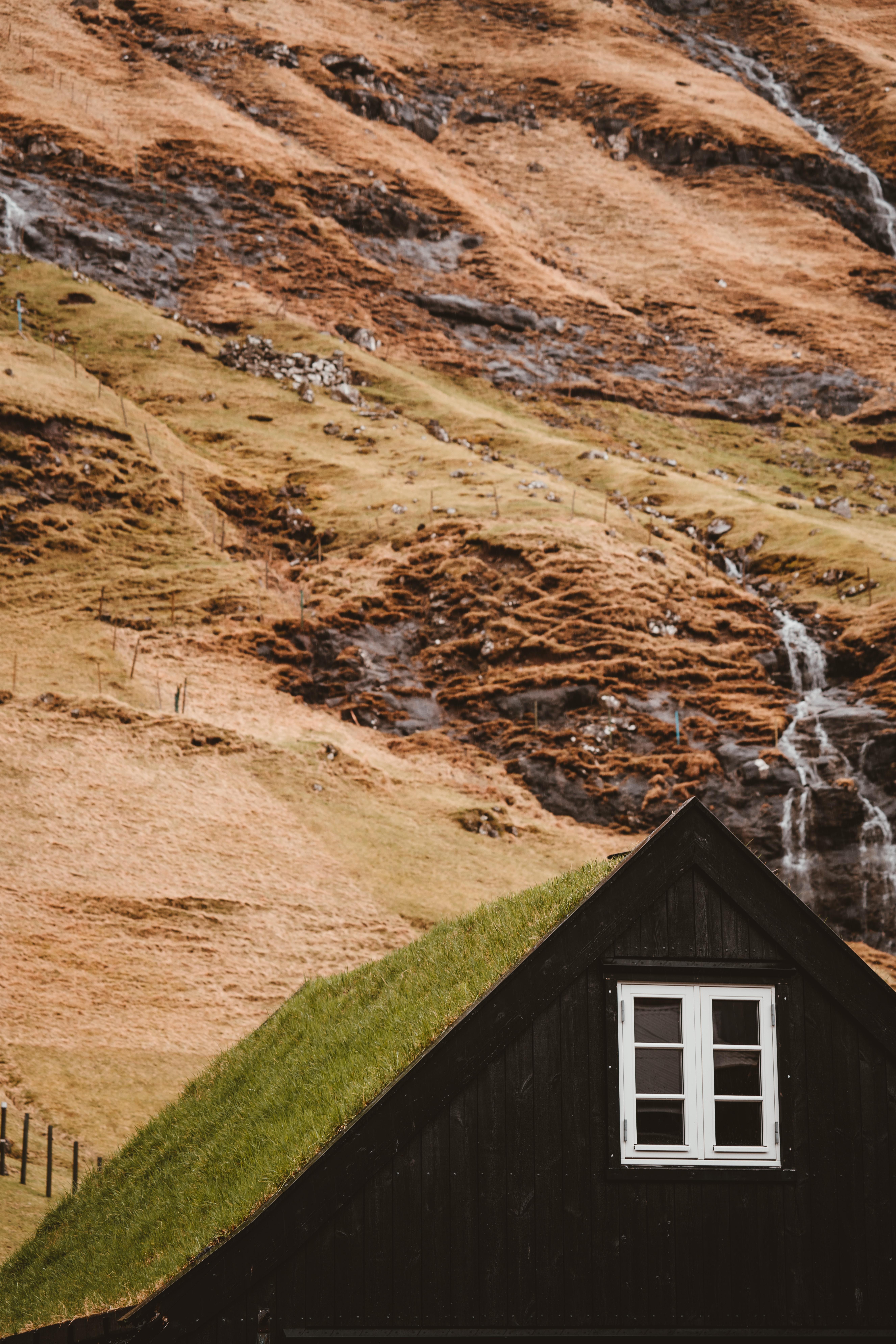 green house beside mountain