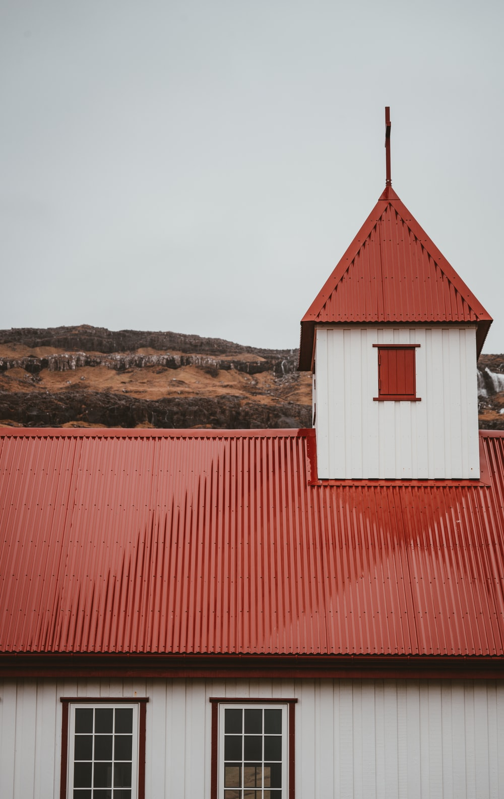 red and white building under cloudy sky during daytime