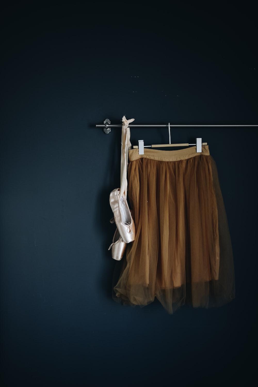 brown skirt hanged on wall