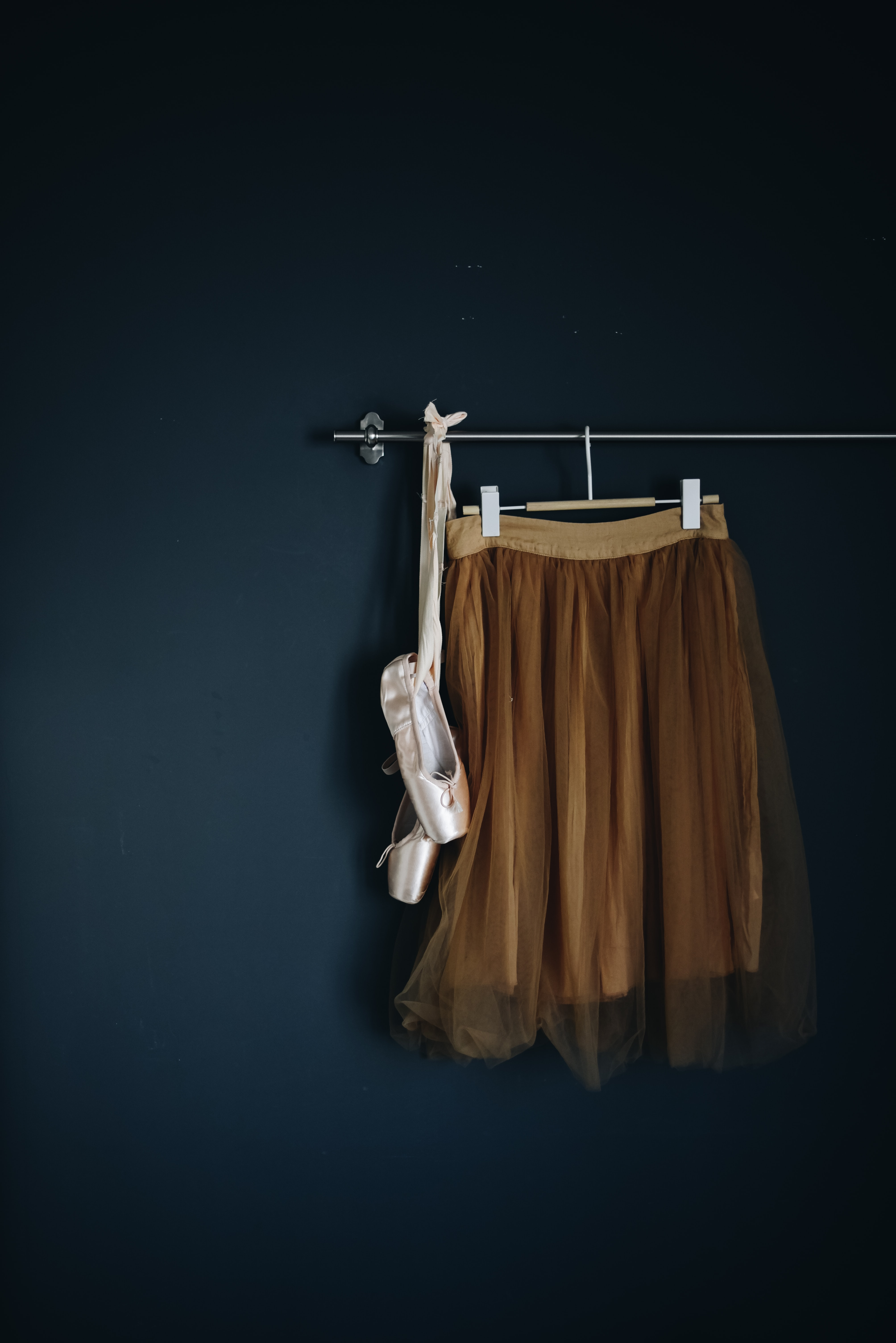 brown skirt hanged on wall