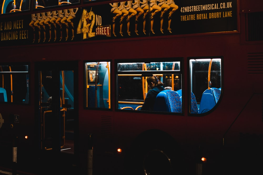 person riding inside double deck bus