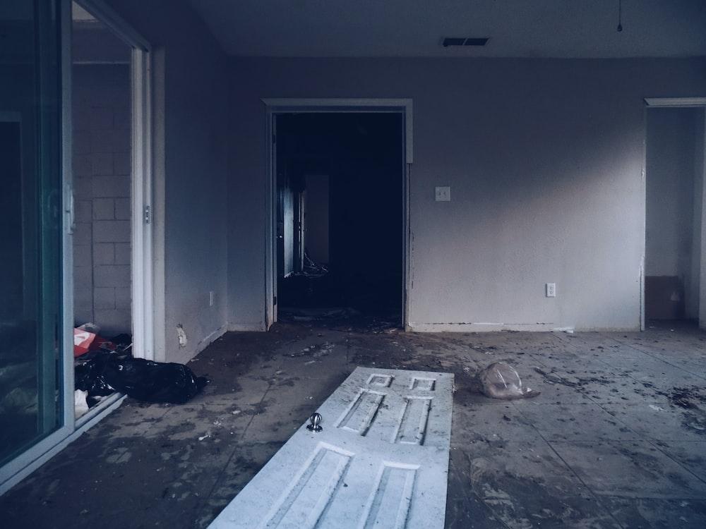 photography of broken door near room