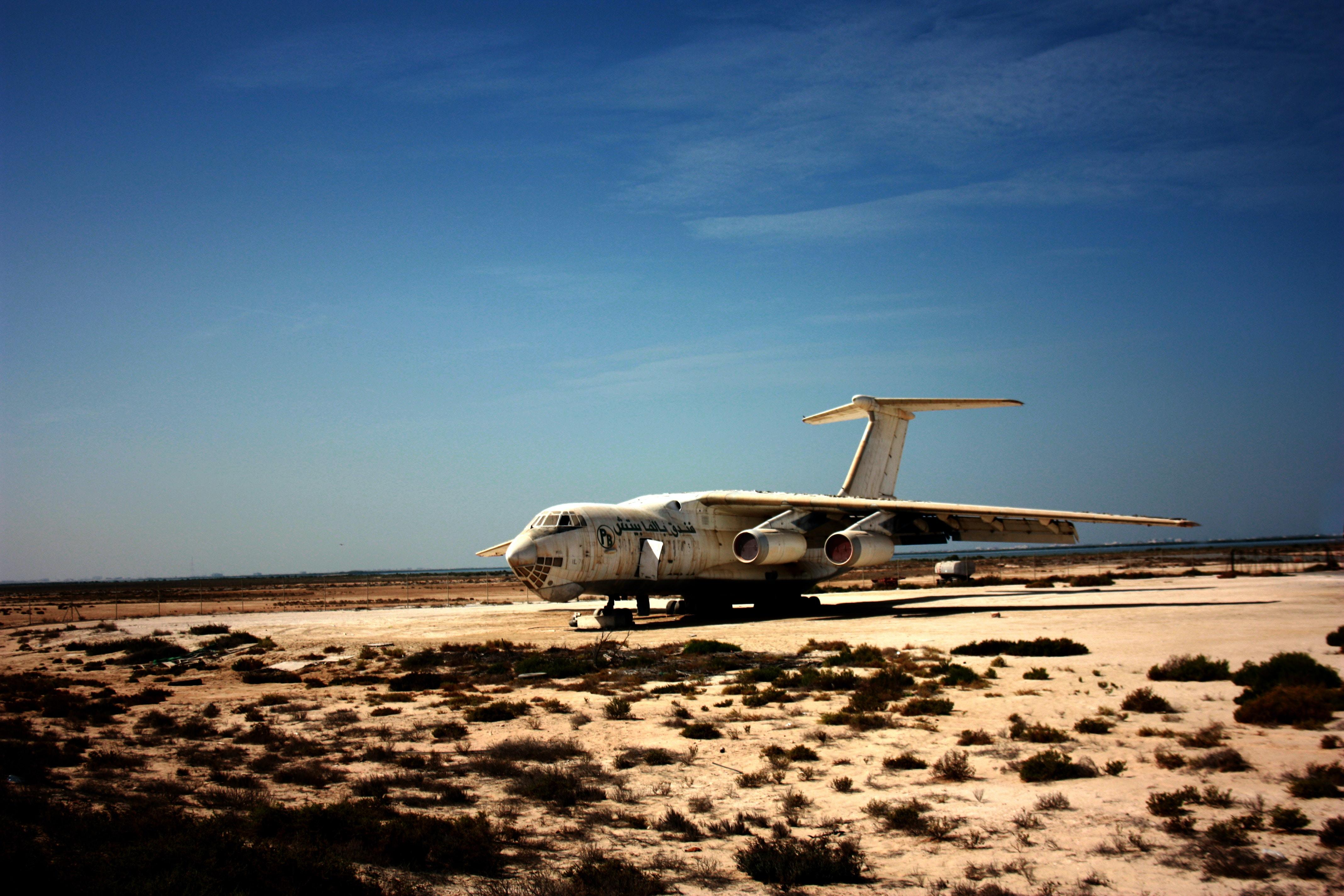 white airliner under blue sky during daytime