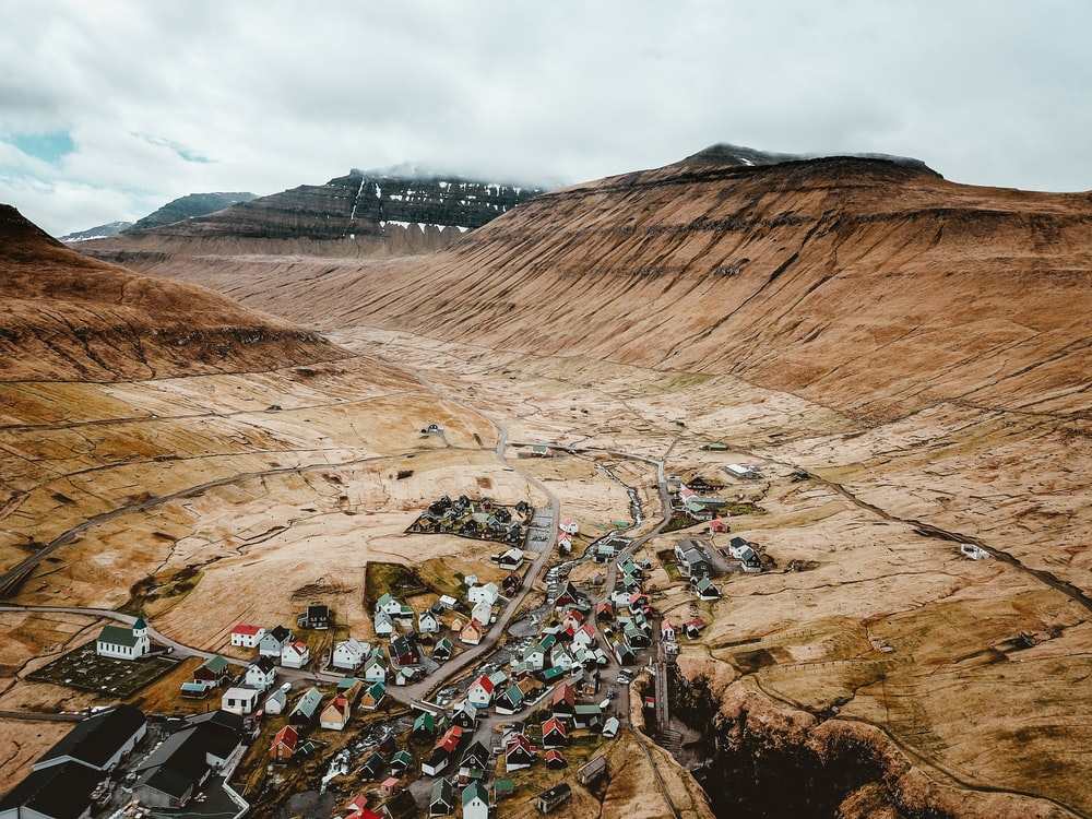 top view photo of houses surrounded by mountain